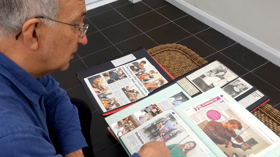Keith talks us through some of his recent students high grades in his scrapbook