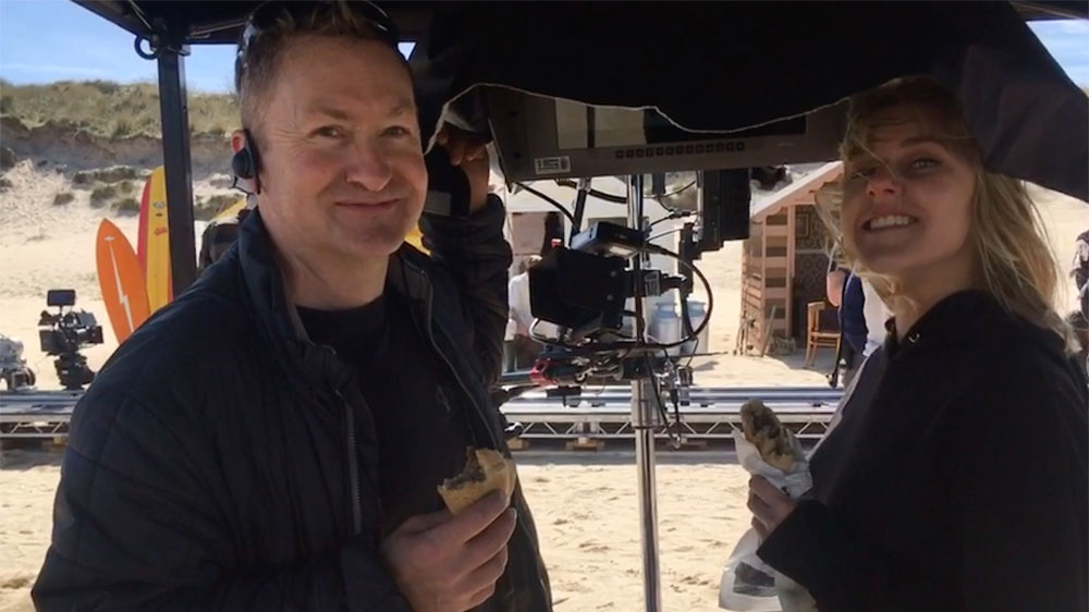 mark Brindle enjoying a Cornish Pasty on set of Kellys Cornish Icecream commercial featuring beach huts at Hayle Cirnwall