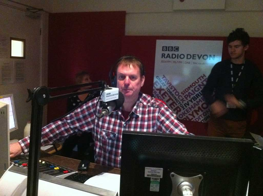 John Govier behind the microphone on BBC Radio Devon