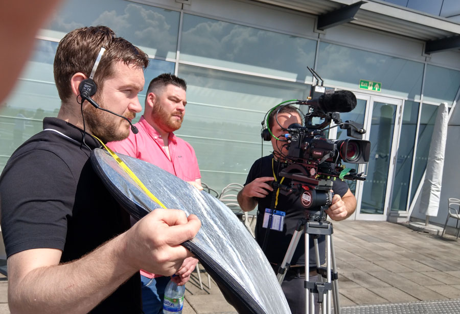 Ben and Pete make use of the sunshine to Interview racers looking over the track