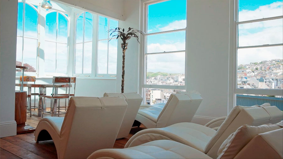 Relax in the sun room at Slimmeria Retreats Ilfracombe