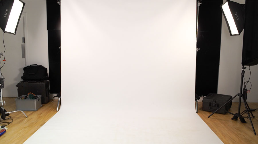 Hire our white screen backdrop with lighting for your next corporate video shoot